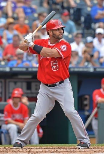 Jun 29, 2014; Kansas City, MO, USA; Los Angeles Angels designated hitter Albert Pujols (5) at bat against the Kansas City Royals during the third inning at Kauffman Stadium. Mandatory Credit: Peter G. Aiken-USA TODAY Sports