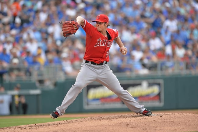 Jun 29, 2014; Kansas City, MO, USA; Los Angeles Angels pitcher C.J. Wison (33) delivers a pitch against the Kansas City Royals during the first inning at Kauffman Stadium. Mandatory Credit: Peter G. Aiken-USA TODAY Sports