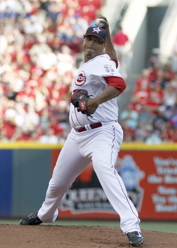 Jul 4, 2014; Cincinnati, OH, USA; Cincinnati Reds starting pitcher Alfredo Simon throws against the Milwaukee Brewers during the first inning at Great American Ball Park. Mandatory Credit: David Kohl-USA TODAY Sports