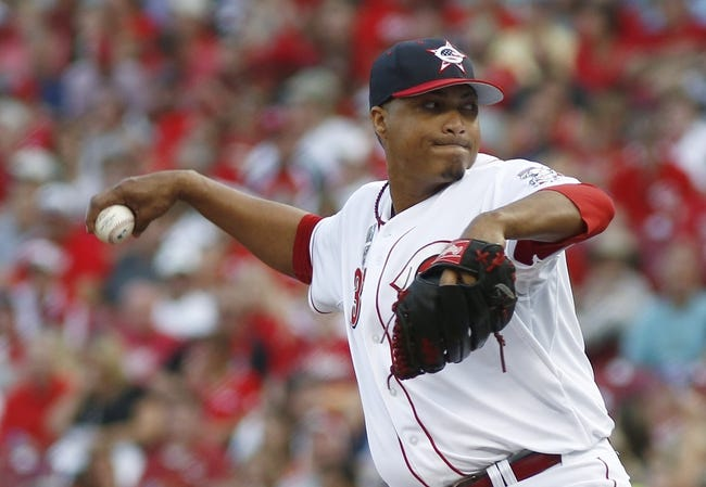 Jul 4, 2014; Cincinnati, OH, USA; Cincinnati Reds starting pitcher Alfredo Simon throws a pitch during the third inning against the Milwaukee Brewers at Great American Ball Park. Mandatory Credit: David Kohl-USA TODAY Sports