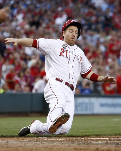 Jul 4, 2014; Cincinnati, OH, USA; Cincinnati Reds third baseman Todd Frazier scores at home plate after a double by first baseman Joey Votto during the fifth inning against the Milwaukee Brewers at Great American Ball Park. Mandatory Credit: David Kohl-USA TODAY Sports