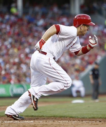 Jul 4, 2014; Cincinnati, OH, USA; Cincinnati Reds third baseman Todd Frazier runs to first during the fifth inning against the Milwaukee Brewers at Great American Ball Park. Mandatory Credit: David Kohl-USA TODAY Sports