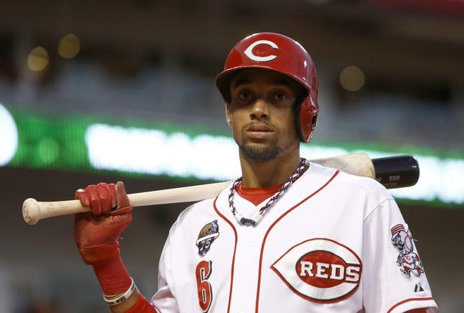 Jul 4, 2014; Cincinnati, OH, USA; Cincinnati Reds center fielder Billy Hamilton stands on deck during a game against the Milwaukee Brewers at Great American Ball Park. Mandatory Credit: David Kohl-USA TODAY Sports
