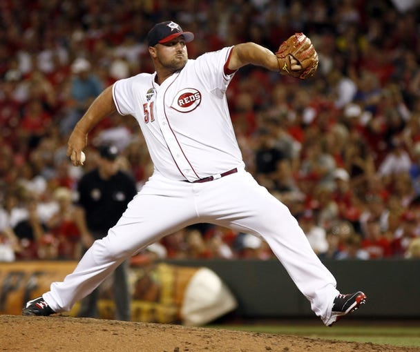 Jul 4, 2014; Cincinnati, OH, USA; Cincinnati Reds relief pitcher Jonathan Broxton throws against the Milwaukee Brewers during the eighth inning at Great American Ball Park. Mandatory Credit: David Kohl-USA TODAY Sports
