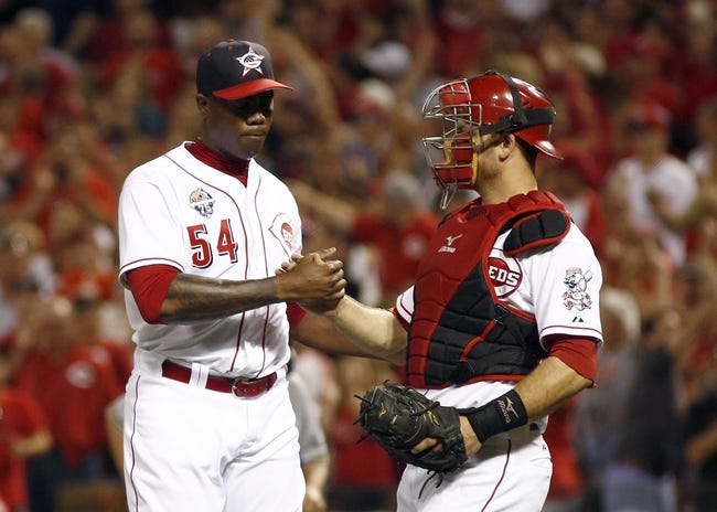 Jul 4, 2014; Cincinnati, OH, USA; Cincinnati Reds relief pitcher Aroldis Chapman (54) is congratulated by Cincinnati Reds catcher Devin Mesoraco after the Reds defeated the Milwaukee Brewers 4-2 at Great American Ball Park. Mandatory Credit: David Kohl-USA TODAY Sports