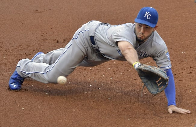 Jul 5, 2014; Cleveland, OH, USA; Kansas City Royals first baseman Eric Hosmer (35) dives for a base hit by Cleveland Indians third baseman Lonnie Chisenhall (not pictured) in the second inning at Progressive Field. Mandatory Credit: David Richard-USA TODAY Sports