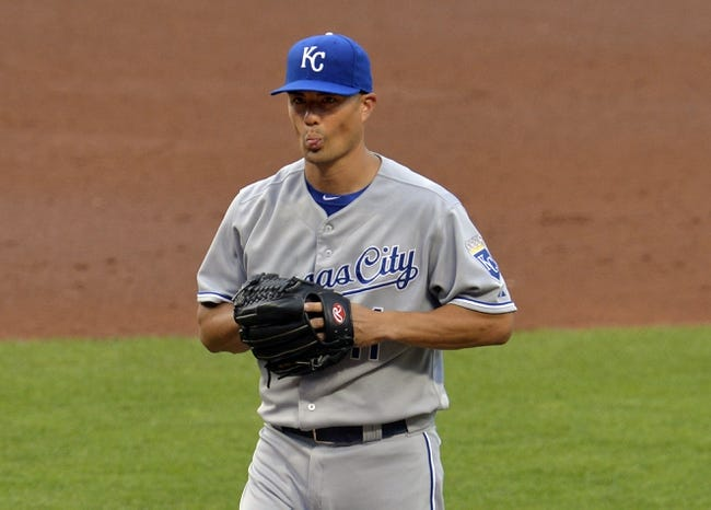 Jul 5, 2014; Cleveland, OH, USA; Kansas City Royals starting pitcher Jeremy Guthrie (11) reacts after giving up a home run in the third inning against the Cleveland Indians at Progressive Field. Mandatory Credit: David Richard-USA TODAY Sports