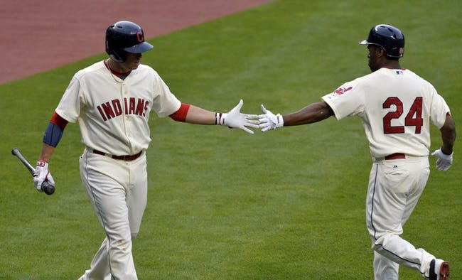 Jul 5, 2014; Cleveland, OH, USA; Cleveland Indians center fielder Michael Bourn (24) celebrates his solo home with shortstop Asdrubal Cabrera (13) in the third inning against the Kansas City Royals at Progressive Field. Mandatory Credit: David Richard-USA TODAY Sports
