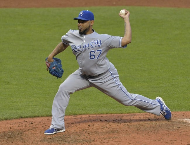 Jul 5, 2014; Cleveland, OH, USA; Kansas City Royals relief pitcher Francisley Bueno (67) delivers in the fifth inning against the Cleveland Indians at Progressive Field. Mandatory Credit: David Richard-USA TODAY Sports