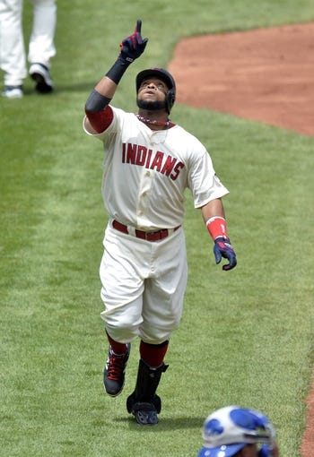Jul 6, 2014; Cleveland, OH, USA; Cleveland Indians first baseman Carlos Santana (41) celebrates his solo home run in the second inning against the Kansas City Royals at Progressive Field. Mandatory Credit: David Richard-USA TODAY Sports