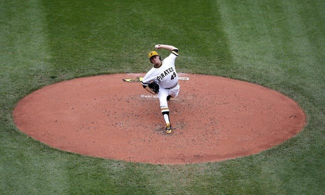 Jul 6, 2014; Pittsburgh, PA, USA; Pittsburgh Pirates starting pitcher Jeff Locke (49) pitches against the Philadelphia Phillies during the fourth inning at PNC Park. Mandatory Credit: Charles LeClaire-USA TODAY Sports