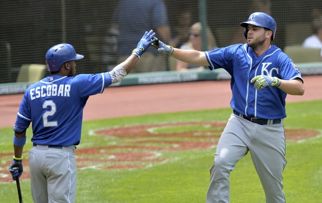 Jul 6, 2014; Cleveland, OH, USA; Kansas City Royals third baseman Mike Moustakas (right) celebrates his solo home run with shortstop Alcides Escobar (2) in the fifth inning against the Cleveland Indians at Progressive Field. Mandatory Credit: David Richard-USA TODAY Sports