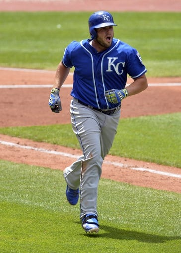 Jul 6, 2014; Cleveland, OH, USA; Kansas City Royals third baseman Mike Moustakas (8) watches his solo home run in the fifth inning against the Cleveland Indians at Progressive Field. Mandatory Credit: David Richard-USA TODAY Sports