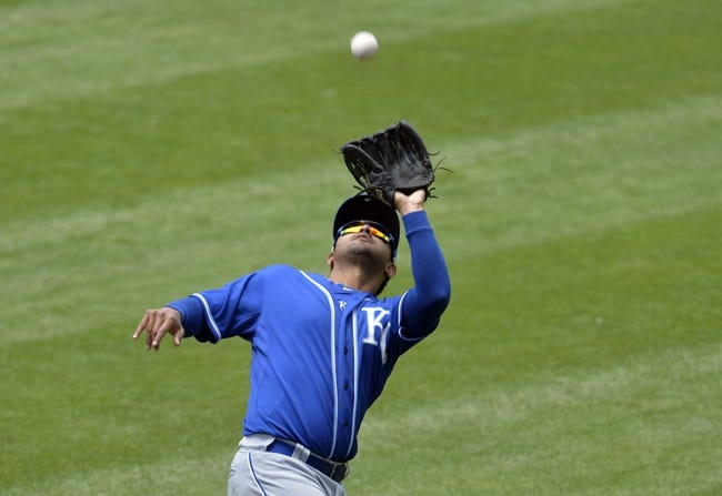 Jul 6, 2014; Cleveland, OH, USA; Kansas City Royals second baseman Christian Colon (24) makes a catch in the fourth inning against the Cleveland Indians at Progressive Field. Mandatory Credit: David Richard-USA TODAY Sports