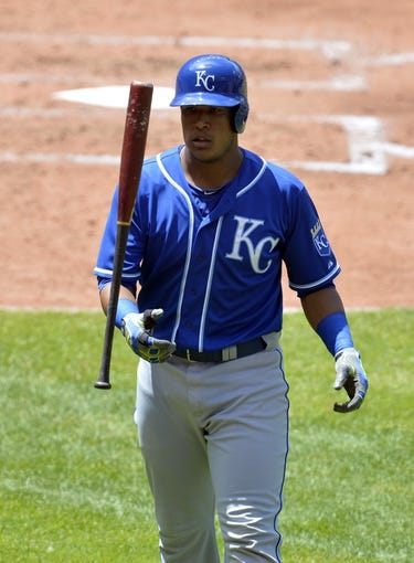 Jul 6, 2014; Cleveland, OH, USA; Kansas City Royals catcher Salvador Perez (13) reacts after striking out in the fourth inning against the Cleveland Indians at Progressive Field. Mandatory Credit: David Richard-USA TODAY Sports