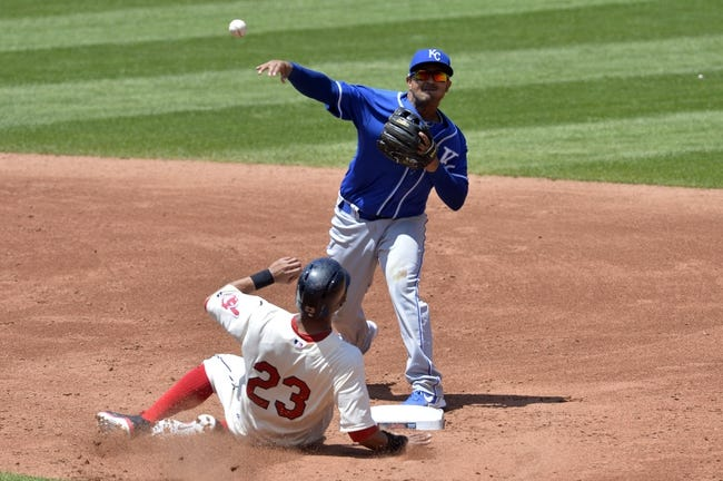 Jul 6, 2014; Cleveland, OH, USA; Kansas City Royals second baseman Christian Colon (24) turns a double play over Cleveland Indians center fielder Michael Brantley (23) in the third inning at Progressive Field. Mandatory Credit: David Richard-USA TODAY Sports