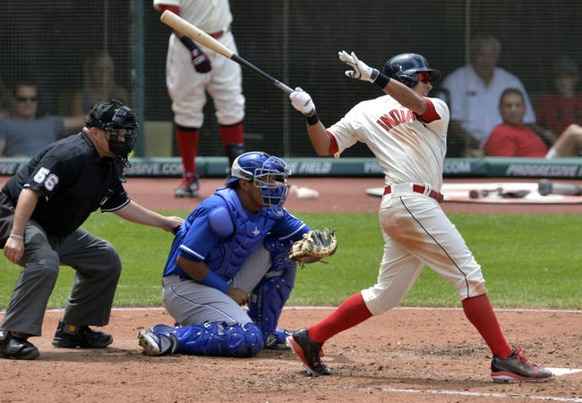 Jul 6, 2014; Cleveland, OH, USA; Cleveland Indians center fielder Michael Brantley (23) hits an RBI single in the fifth inning against the Kansas City Royals at Progressive Field. Mandatory Credit: David Richard-USA TODAY Sports