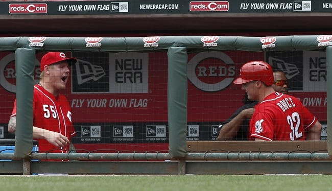 Jul 6, 2014; Cincinnati, OH, USA; Cincinnati Reds right fielder Jay Bruce (32) is congratulated in the dugout by starting pitcher Mat Latos (55) after hitting a two-run home run against the Milwaukee Brewers during the eighth inning at Great American Ball Park.  The Reds won 4-2. Mandatory Credit: David Kohl-USA TODAY Sports