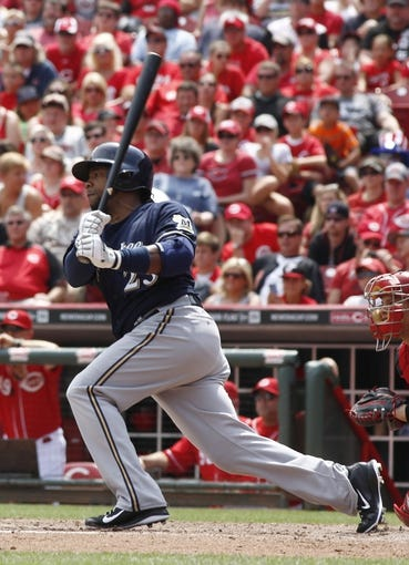 Jul 6, 2014; Cincinnati, OH, USA; Milwaukee Brewers pinch hitter  Rickie Weeks hits an RBI single against the Cincinnati Reds during the eighth inning at Great American Ball Park. The Reds won 4-2. Mandatory Credit: David Kohl-USA TODAY Sports