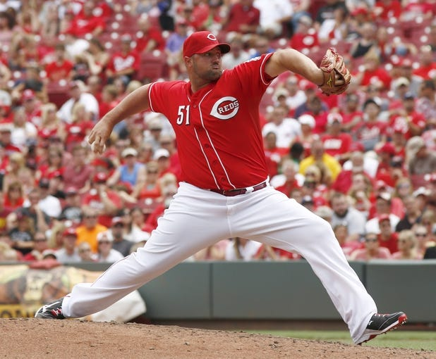 Jul 6, 2014; Cincinnati, OH, USA; Cincinnati Reds relief pitcher Jonathan Broxton throws against the Milwaukee Brewers during the ninth inning at Great American Ball Park. The Reds won 4-2. Mandatory Credit: David Kohl-USA TODAY Sports
