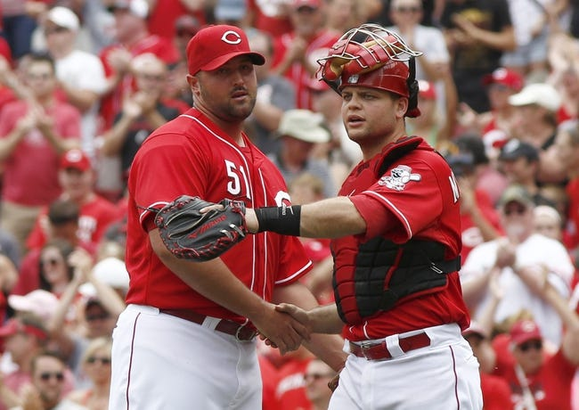 Jul 6, 2014; Cincinnati, OH, USA; Cincinnati Reds relief pitcher Jonathan Broxton (51) is congratulated by catcher Devin Mesoraco  after the Reds defeated the Milwaukee Brewers 4-2 at Great American Ball Park. Mandatory Credit: David Kohl-USA TODAY Sports