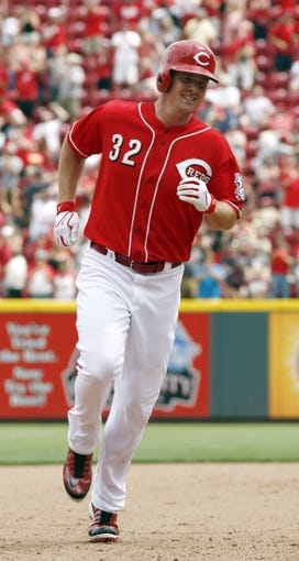 Jul 6, 2014; Cincinnati, OH, USA; Cincinnati Reds right fielder Jay Bruce rounds the bases after hitting a two-home run against the Milwaukee Brewers during the eighth inning at Great American Ball Park. The Reds won 4-2. Mandatory Credit: David Kohl-USA TODAY Sports