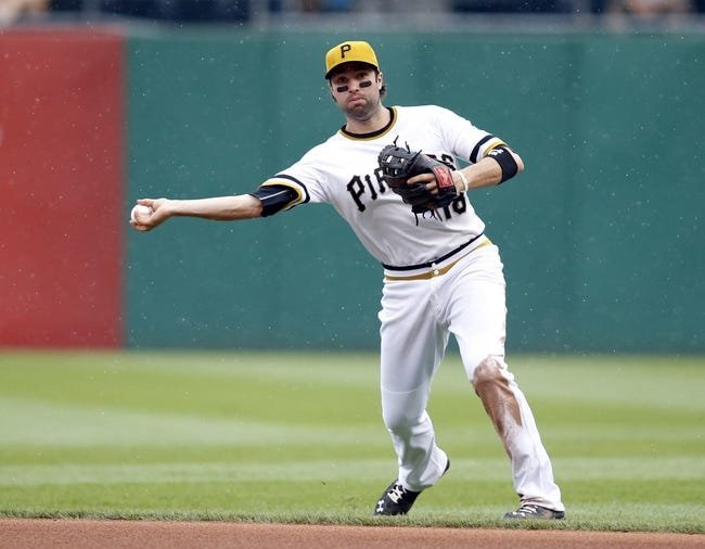 Jul 6, 2014; Pittsburgh, PA, USA; Pittsburgh Pirates second baseman Neil Walker (18) throws to first base against the Philadelphia Phillies during the eighth inning at PNC Park. The Pirates won 6-2. Mandatory Credit: Charles LeClaire-USA TODAY Sports