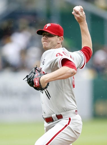 Jul 6, 2014; Pittsburgh, PA, USA; Philadelphia Phillies relief pitcher Justin De Fratus (30) pitches against the Pittsburgh Pirates during the eighth inning at PNC Park. The Pirates won 6-2. Mandatory Credit: Charles LeClaire-USA TODAY Sports