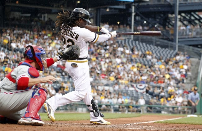 Jul 6, 2014; Pittsburgh, PA, USA; Pittsburgh Pirates center fielder Andrew McCutchen (22) hits an RBI triple against the Philadelphia Phillies during the eighth inning at PNC Park. The Pirates won 6-2. Mandatory Credit: Charles LeClaire-USA TODAY Sports
