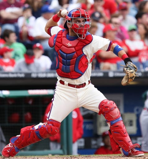 May 18, 2014; Philadelphia, PA, USA; Philadelphia Phillies catcher Wil Nieves (21) throws the ball in a game against the Cincinnati Reds at Citizens Bank Park. The Phillies won 8-3. Mandatory Credit: Bill Streicher-USA TODAY Sports
