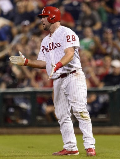Sep 10, 2013; Philadelphia, PA, USA; Philadelphia Phillies catcher Cameron Rupp (29) celebrates after getting his first hit during the eighth inning against the San Diego Padres at Citizens Bank Park. The Padres defeated the Phillies 8-2. Mandatory Credit: Howard Smith-USA TODAY Sports