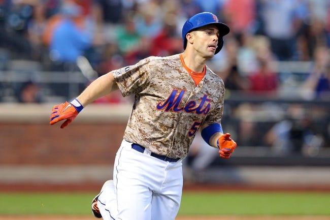 Jul 7, 2014; New York, NY, USA; New York Mets third baseman David Wright (5) rounds the bases after hitting a solo home run against the Atlanta Braves during the third inning of a game at Citi Field. Mandatory Credit: Brad Penner-USA TODAY Sports