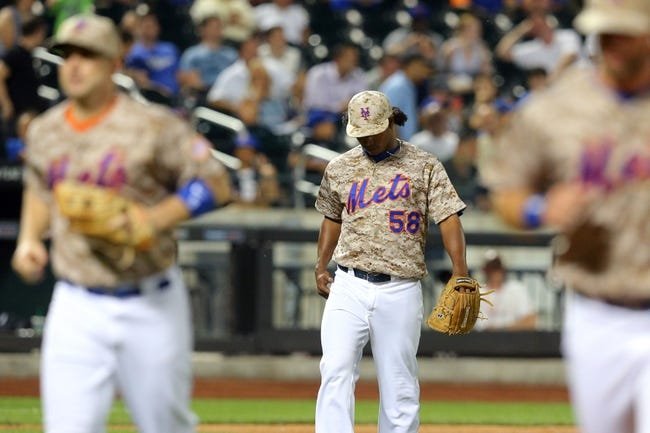 Jul 7, 2014; New York, NY, USA; New York Mets relief pitcher Jenrry Mejia (58) reacts after allowing the Atlanta Braves to score the go-ahead run during the eighth inning of a game at Citi Field. Mandatory Credit: Brad Penner-USA TODAY Sports