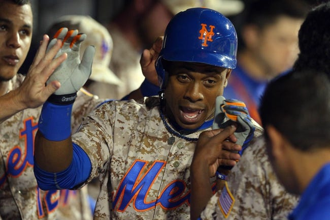 Jul 7, 2014; New York, NY, USA; New York Mets right fielder Curtis Granderson (3) is congratulated in the dugout after hitting a game-tying home run against the Atlanta Braves during the eighth inning of a game at Citi Field. Mandatory Credit: Brad Penner-USA TODAY Sports