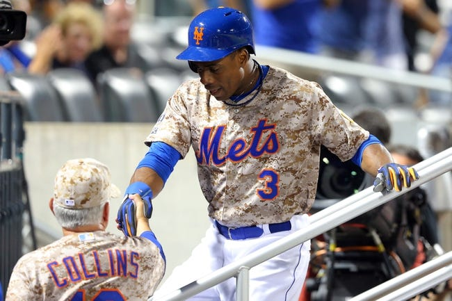 Jul 7, 2014; New York, NY, USA; New York Mets right fielder Curtis Granderson (3) is greeted in the dugout by manager Terry Collins (10) after hitting a game-tying home run against the Atlanta Braves during the eighth inning of a game at Citi Field. Mandatory Credit: Brad Penner-USA TODAY Sports