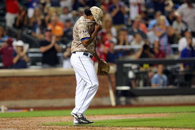 Jul 7, 2014; New York, NY, USA; New York Mets relief pitcher Jenrry Mejia (58) reacts after allowing the Atlanta Braves to score a run during the eighth inning of a game at Citi Field. Mandatory Credit: Brad Penner-USA TODAY Sports