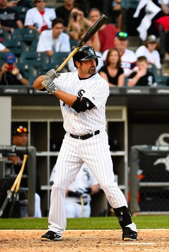 Jul 1, 2014; Chicago, IL, USA; Chicago White Sox designated hitter Paul Konerko (14) during the ninth inning at U.S Cellular Field. Mandatory Credit: Mike DiNovo-USA TODAY Sports