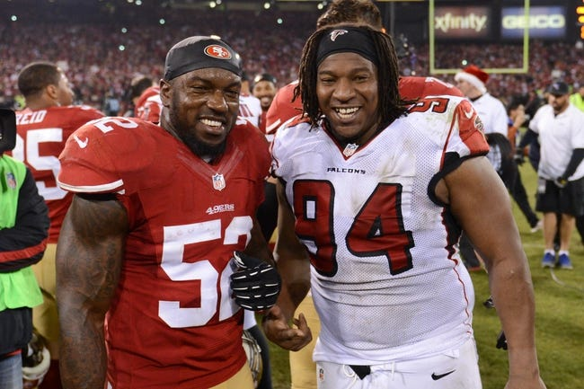 December 23, 2013; San Francisco, CA, USA; San Francisco 49ers inside linebacker Patrick Willis (52) and Atlanta Falcons defensive tackle Peria Jerry (94) pose for a photo after the final regular season game at Candlestick Park. The 49ers defeated the Falcons 34-24. Mandatory Credit: Kyle Terada-USA TODAY Sports