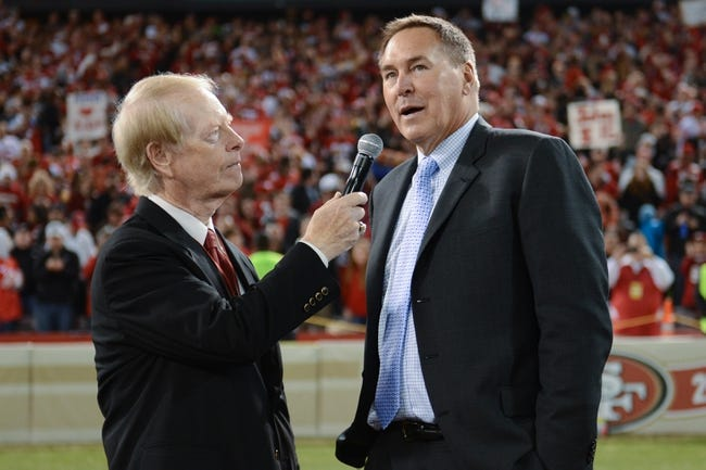 December 23, 2013; San Francisco, CA, USA; American sportscaster Joe Starkey (left) interviews former San Francisco 49ers wide receiver Dwight Clark during halftime in the final regular season game against the Atlanta Falcons at Candlestick Park. Mandatory Credit: Kyle Terada-USA TODAY Sports
