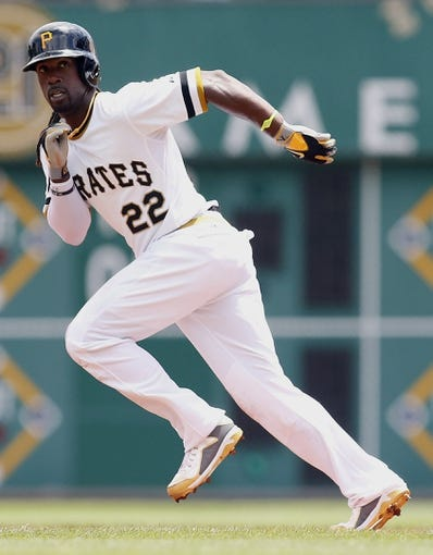 Jul 6, 2014; Pittsburgh, PA, USA; Pittsburgh Pirates center fielder Andrew McCutchen (22) runs the bases against the Philadelphia Phillies during the first inning at PNC Park. The Pirates won 6-2. Mandatory Credit: Charles LeClaire-USA TODAY Sports