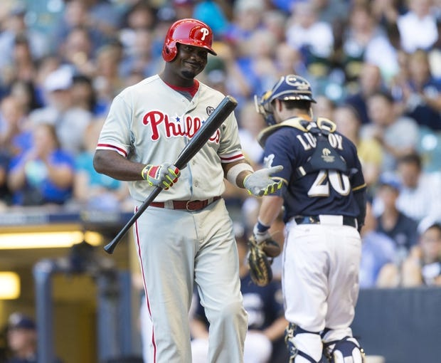 Jul 8, 2014; Milwaukee, WI, USA; Philadelphia Phillies first baseman Ryan Howard (6) reacts after striking out during the first inning against the Milwaukee Brewers at Miller Park. Mandatory Credit: Jeff Hanisch-USA TODAY Sports