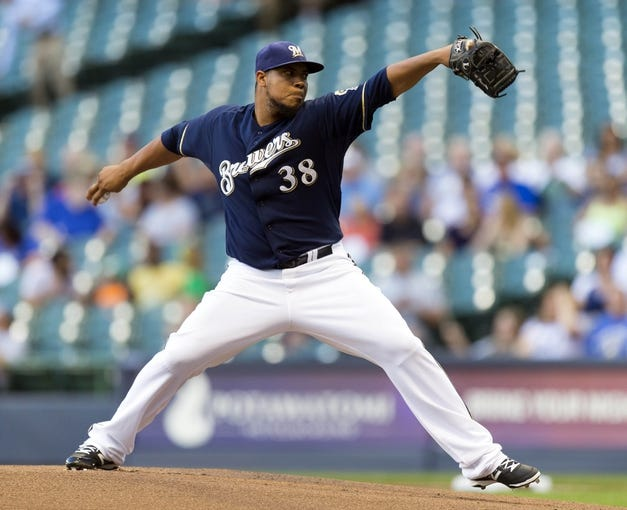Jul 8, 2014; Milwaukee, WI, USA; Milwaukee Brewers pitcher Wily Peralta (38) throws a pitch during the first inning against the Philadelphia Phillies at Miller Park. Mandatory Credit: Jeff Hanisch-USA TODAY Sports