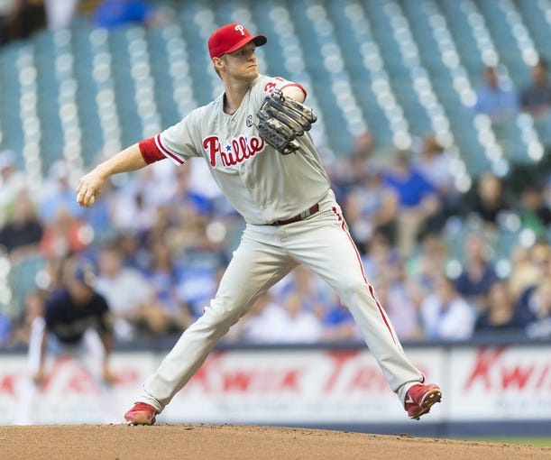 Jul 8, 2014; Milwaukee, WI, USA; Philadelphia Phillies pitcher Kyle Kendrick (38) throws a pitch during the first inning against the Milwaukee Brewers at Miller Park. Mandatory Credit: Jeff Hanisch-USA TODAY Sports