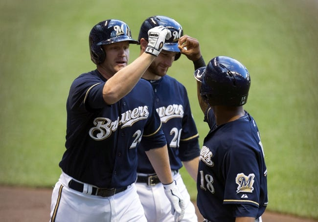 Jul 8, 2014; Milwaukee, WI, USA; Milwaukee Brewers first baseman Lyle Overbay (24) is congratulated by left fielder Khris Davis (18) after hitting a grand slam home run during the first inning against the Philadelphia Phillies at Miller Park. Mandatory Credit: Jeff Hanisch-USA TODAY Sports