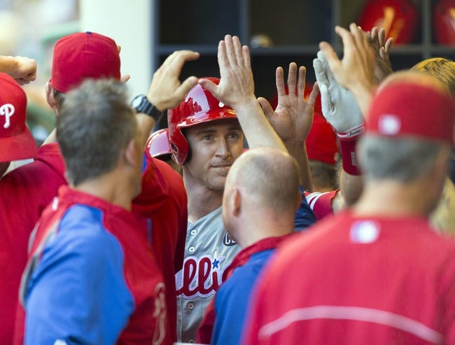 Jul 8, 2014; Milwaukee, WI, USA; Philadelphia Phillies second baseman Chase Utley (26) celebrates with teammates during the first inning against the Milwaukee Brewers at Miller Park. Mandatory Credit: Jeff Hanisch-USA TODAY Sports