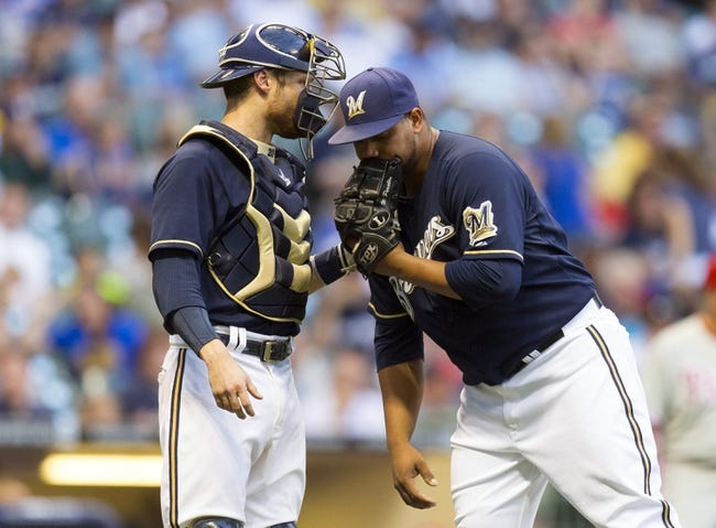 Jul 8, 2014; Milwaukee, WI, USA; Milwaukee Brewers catcher Jonathan Lucroy (20) talks with pitcher Wily Peralta (38) during the second inning against the Philadelphia Phillies at Miller Park. Mandatory Credit: Jeff Hanisch-USA TODAY Sports