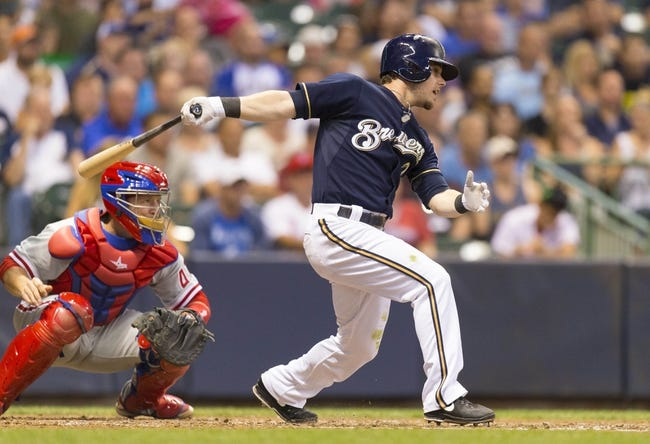 Jul 8, 2014; Milwaukee, WI, USA; Milwaukee Brewers second baseman Scooter Gennett (2) singles during the fourth inning against the Philadelphia Phillies at Miller Park. Mandatory Credit: Jeff Hanisch-USA TODAY Sports