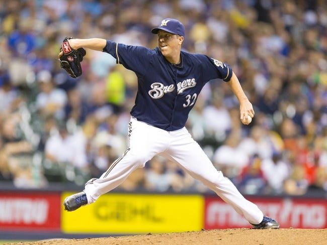 Jul 8, 2014; Milwaukee, WI, USA; Milwaukee Brewers pitcher Tom Gorzelanny (32) throws a pitch during the fifth inning against the Philadelphia Phillies at Miller Park. Mandatory Credit: Jeff Hanisch-USA TODAY Sports