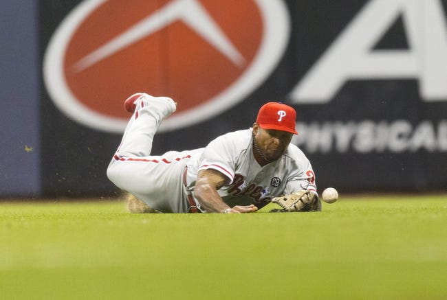 Jul 8, 2014; Milwaukee, WI, USA; Philadelphia Phillies right fielder Marlon Byrd (3) tries to make a diving catch during the sixth inning against the Milwaukee Brewers at Miller Park. Mandatory Credit: Jeff Hanisch-USA TODAY Sports