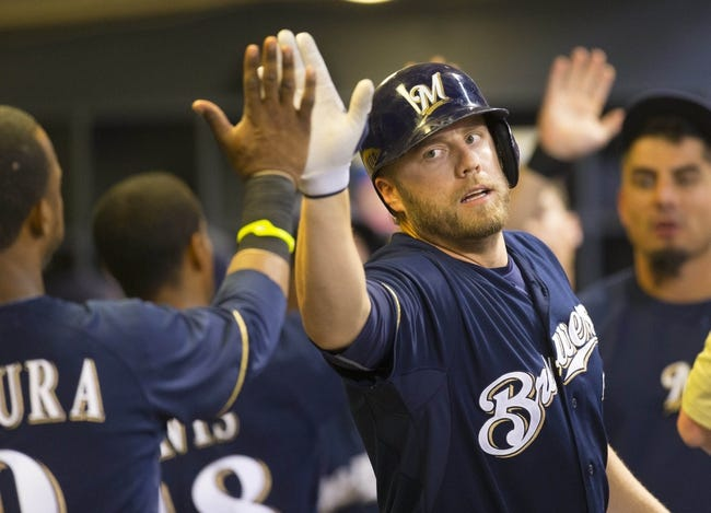 Jul 8, 2014; Milwaukee, WI, USA; Milwaukee Brewers first baseman Mark Reynolds (7) high fives shortstop Jean Segura (9) after hitting a home run during the sixth inning against the Philadelphia Phillies at Miller Park. Mandatory Credit: Jeff Hanisch-USA TODAY Sports